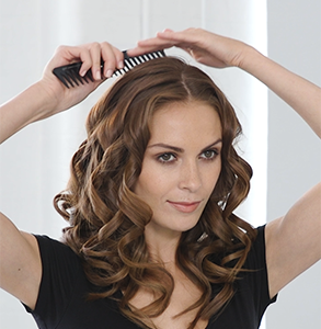 step nine: Dress curls with detangling comb