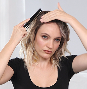 step twelve: Dress curls with detangling comb