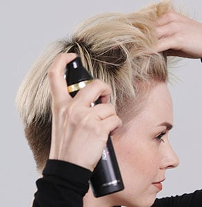 step one: Spray hair with curl hold and root lift sprays