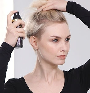 step one: Spray hair with root lift product