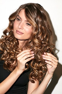 Disco Curls - Separate curls with fingers and spritz with final fix hairspray