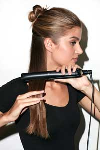 Freestyle Feather - Section hair from ear to ear and secure away, then place styler at root and glide to end
