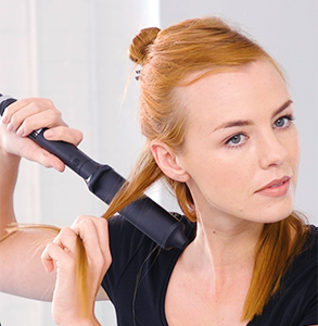 step four: Place curling wand above hair at root pointing downwards