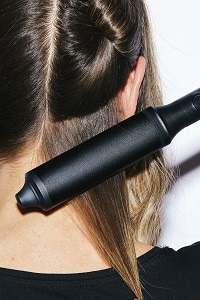 step two: Twist wrap hair around a curling wand