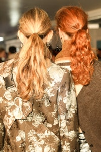 Two model's with styled hair.