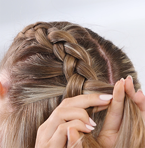 step nine: Repeat steps 7 and 8, keeping braid tight