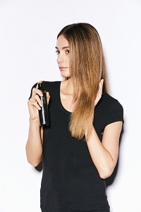 step one: Prep dry hair with ghd curl hold spray and distribute evenly through to ends