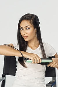 Step 6: Glide the brush and the styler down the section, smoothly and slowly to the ends