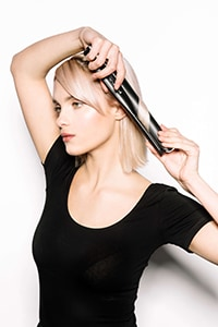 Rotate styler in opposite direction, glide one width - Textured Bob