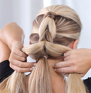 step nine: Join sections for ponytail C with sections of ponytail B, tie together under ponytail A