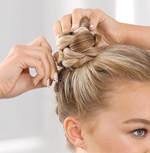 step fifteen: Twist each braid into buns and secure