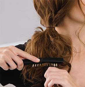 step ten: Tease ponytail with dressing brush
