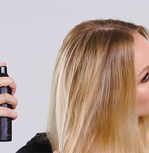 step one: Spray root lift product onto hair