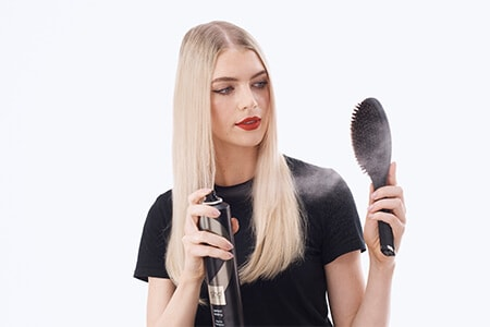 Step 6: Finish with ghd perfect ending hairspray and an oval dressing brush
