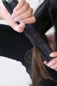 step six: Repeat steps three to five on the next section of hair, but rotate the styler towards the face