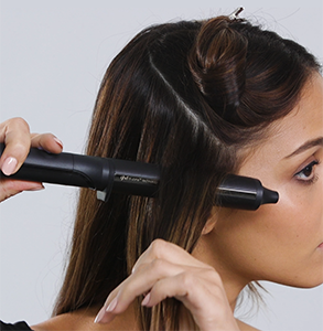 step three: At bottom, take diagonal section and place curling wand below hair facing towards face