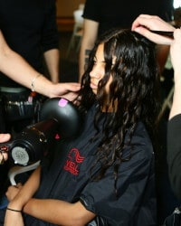 Team style model's hair using ghd air hairdryer and diffuser.