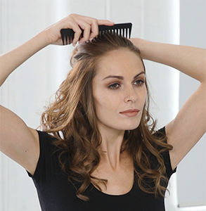 step eight: Brush hair back with comb