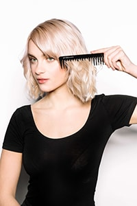Work through hair with detangling comb - Textured Bob