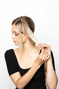 Create triangle section of hair and secure rest away - Subtle Sleek Crimp