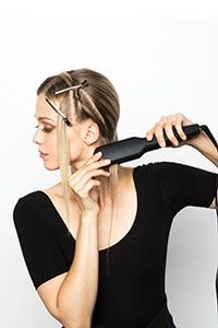 Take small section, place in crimper at root and hold - Subtle Sleek Crimp