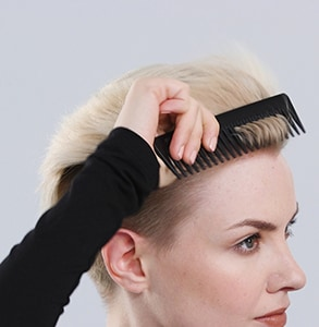 step four: Grip hair with comb for lift