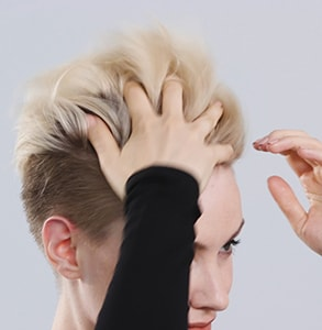 step eight: Spray final fix spray on fingers, work through hair to create root lift