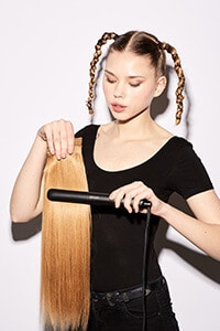 step seven: Glide styler through hair extensions