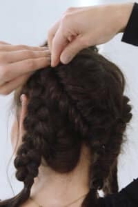 step nine: Place hair pins in the centre of the braid to secure
