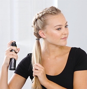 step eleven: Spray remaining hair with curl hold product