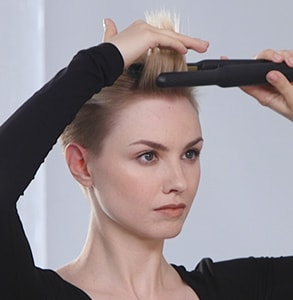 step five: Place styler at hair root