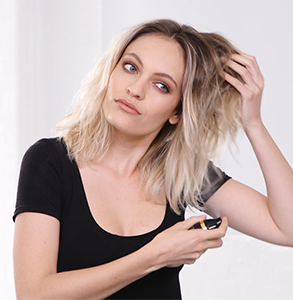 step one: Prep hair with straight and smooth spray