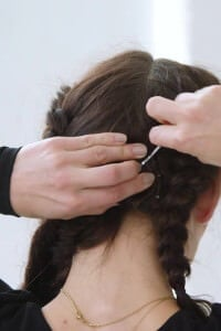 step seven: Clip in a fishtail braid extension at the back of your head in the centre