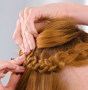 step fifteen: Take end of braid to back, secure with two grips